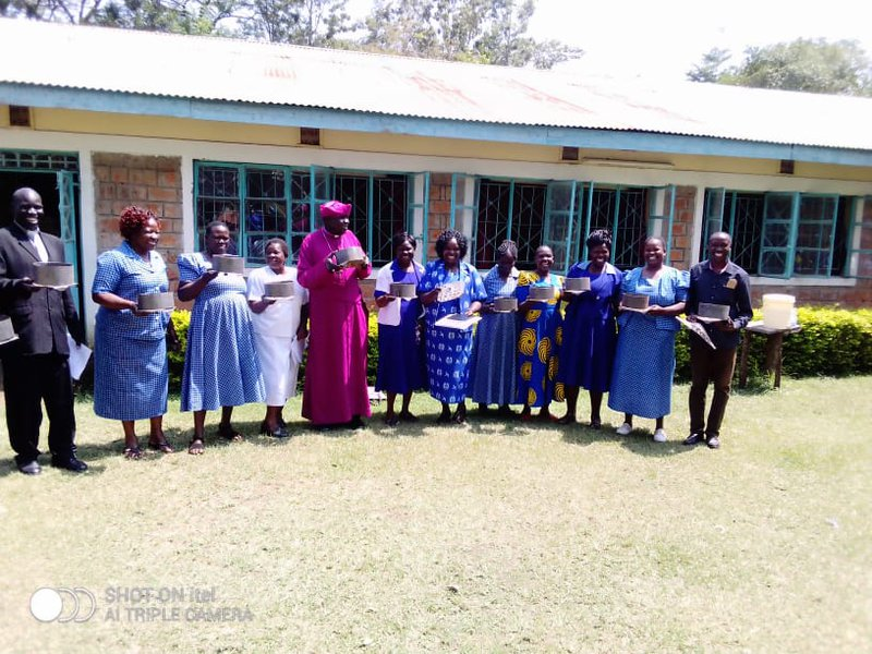 Amani CBO: Mother Union department with Bishop of Katakwa Diocese in a group photo during training women -Sun 24 solar project