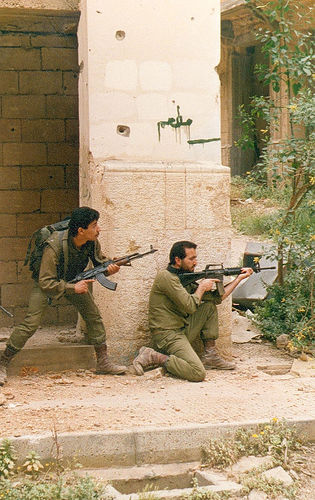 East Beirut 1990: Christian militiamen of the Lebanese Forces moving through the no-mans-land on Beirut's 'green line'. If memory serves me correct, this was spring 1990 - the LF were still engaged in their bloody showdown with Geneal Aoun's army. But here they are looking out for snipers from across the divide in west Beirut.