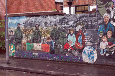 Residential areas can often be identified as predominantly Nationalist or Unionist by their political murals - in this case, from the Nationalist Falls Road. Thanks to jimmyharris. Uploaded under a Creative Commons Attribution License
