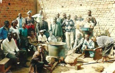 Youth and adult ex-combatants being trained in the production of household soap, activities they will perform as part of their socioeconomic reintegration, in Butembo.