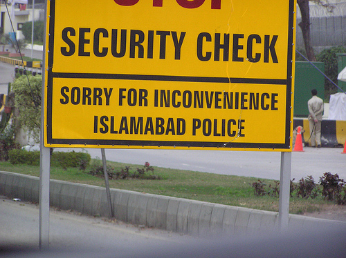 A sign advises of a police security checkpoint in Islamabad, Pakistan.