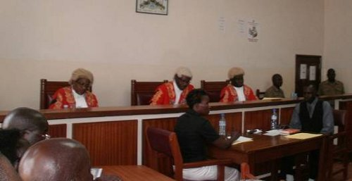 The judges: Justice Nahamya, Justice Akiiza, Justice Owiny-Dollo