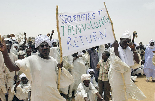 Refugees from Sudan holding up a banner during the visit of Secretary- General Kofi Annan at Iridimi Camp in Chad.