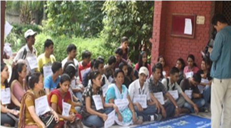 Campaigners in a sit-in in front of UML party Office