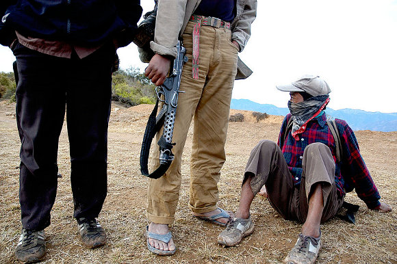 Three Maoist rebels waiting for order on top of a hill in the Rolpa district, Nepal.