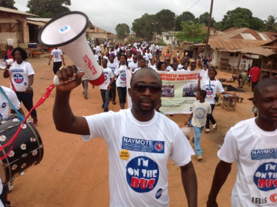 Young volunteers participate in the Liberia Bus Project campaign.