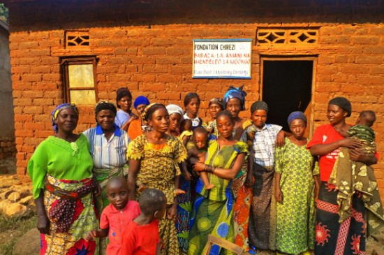 Women's group outside their Baraza at Kigongo