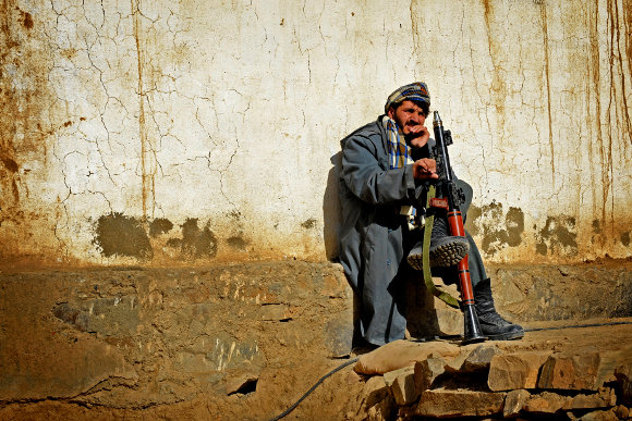 An Afghan police officer at his post. Image credit: James Gordon