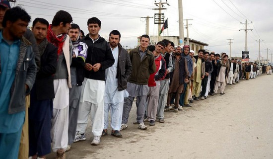 Afghan Elections: Polling station on Jalalabad Road. Voters line up at a polling station on Jalalabad Road, Kabul city, April 5 2014 (Photo credit: Casey Garret Johnson)