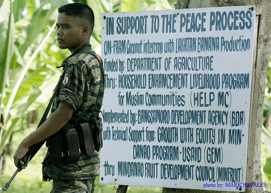 A young Moro rebel standing infront of the sign board at MILF out post, ( A special program from USAID-GEM) inside the MILF Camp Darapanan in Sultan Kudarat, Southern Philippines. Image credit: Mark Navales, https://flic.kr/p/4uaxp