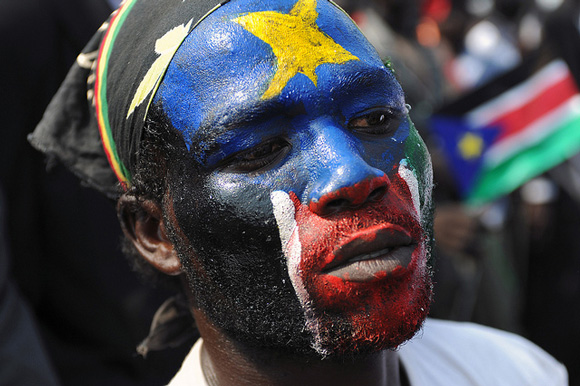 A South Sudanese man celebrates independence