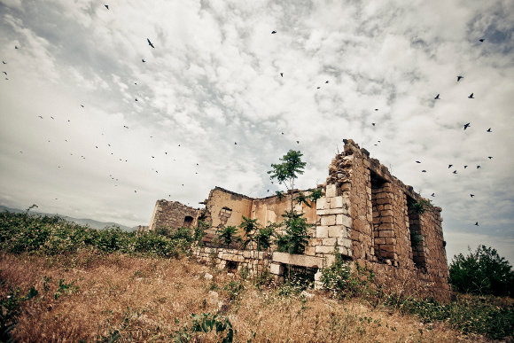A ruined building in the Agdam – the town was abandoned due to the fighting.  Image credit: Marco Fieber
