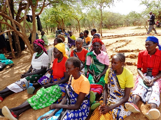 Women at a peace meeting. They are following proceedings while seated, as is traditional. Women play a key role in POKATUSU's work.