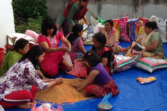 Women preparing relief materials for the victims of the April earthquake, credit: Ambika Pokhrel