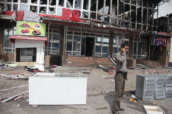 Many homes and properties were destroyed during the 2010 riots, such as this supermarket. Image credit: Inga Sikorskaya.