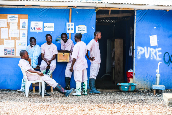 Health workers outside an Ebola treatment centre