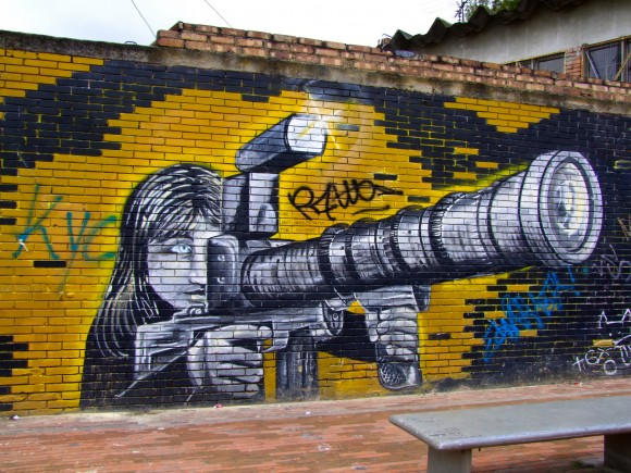 Street art in Colombia depicts violence in every day life. Image credit: Frank Plamann